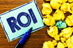 Word writing text Roi. Business concept for Performance measure used to evaluate the efficiency of an investment stock photography