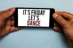 Word writing text It s is Friday Let s is Dance. Business concept for Celebrate starting the weekend Go party Disco Music Human ha. Nd hold smartphone with red stock photos