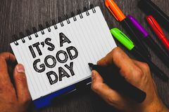 Word writing text It s is A Good Day. Business concept for Happy time great vibes perfect to enjoy life beautiful Hand holding pen. And paper sketch words near Royalty Free Stock Photo