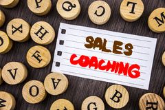 Word, writing, text  Sales Coaching. Conceptual photo Business Goal Achievement Mentoring written on tear notobook paper on the wo. Word, writing, text  Sales Royalty Free Stock Photos