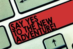 Word writing text Say Yes To The New Adventure. Business concept for Exploring the world traveling life experience. Keyboard key Intention to create computer stock photography