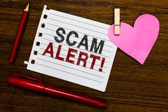 Word writing text Scam Alert. Business concept for warning someone about scheme or fraud notice any unusual Notebook piece paper m. Arkers clothespin holding royalty free stock images