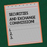 Word writing text Securities And Exchange Commission. Business concept for Safety exchanging commissions financial Lined. Spiral Top Color Notepad photo on royalty free illustration
