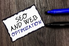Word writing text Seo And Web Optimization. Business concept for Search Engine Keywording Marketing Strategies Black bordered page. With texts laid black and royalty free stock photo