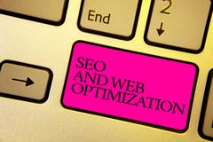 Word writing text Seo And Web Optimization. Business concept for Search Engine Keywording Marketing Strategies Bright golden compu. Ter keyboard with pink button royalty free stock photo