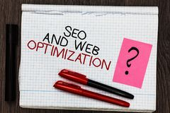 Word writing text Seo And Web Optimization. Business concept for Search Engine Keywording Marketing Strategies Color pen on writte. N notepad with question mark royalty free stock photo