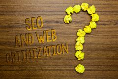 Word writing text Seo And Web Optimization. Business concept for Search Engine Keywording Marketing Strategies Wooden floor with s. Ome letters yellow paper stock photo