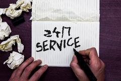 Word writing text 24 7 Service. Business concept for Always available to serve Runs constantly without disruption Man holding mark. Er notebook page crumpled stock photo