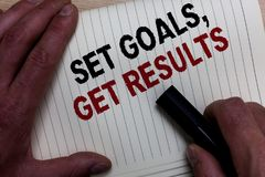 Word writing text Set Goals, Get Results. Business concept for Establish objectives work for accomplish them Man's hand grasp bla. Ck marker with some black and stock photo