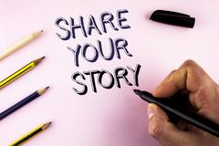 Word writing text Share Your Story. Business concept for Tell personal experiences talk about yourself Storytelling written by Man. Plain background holding Royalty Free Stock Images