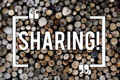 Word writing text Sharing. Business concept for To Share Give a portion of something to another Possess in common Wooden stock photos