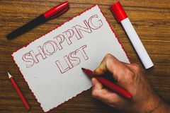Word writing text Shopping List. Business concept for Discipline approach to shopping Basic Items to Buy Man hand holding marker n royalty free stock images