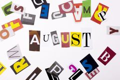 A word writing text showing concept of AUGUST made of different magazine newspaper letter for Business case on the white backgroun Royalty Free Stock Photography