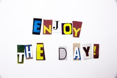 A word writing text showing concept of Enjoy The Day made of different magazine newspaper letter for Business case on the white ba. Ckground with space royalty free stock photo