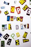 A word writing text showing concept of Enjoy The Day made of different magazine newspaper letter for Business case on the white ba. Ckground with space royalty free stock photography