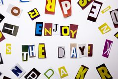 A word writing text showing concept of Enjoy The Day made of different magazine newspaper letter for Business case on the white ba. Ckground with space stock images