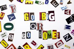 A word writing text showing concept of Go Big Or Go Home made of different magazine newspaper letter for Business case on the whit Royalty Free Stock Photos