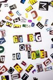 A word writing text showing concept of Go Big Or Go Home made of different magazine newspaper letter for Business case on the whit Stock Photography