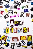A word writing text showing concept of Happy Holidays made of different magazine newspaper letter for Business case on the white b. Ackground with space Royalty Free Stock Images