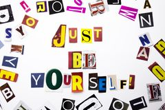 A word writing text showing concept of Just Be Yourself made of different magazine newspaper letter for Business case on the white stock photo