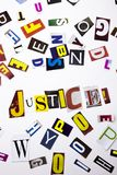 A word writing text showing concept of Justice made of different magazine newspaper letter for Business case on the white backgrou royalty free stock photography