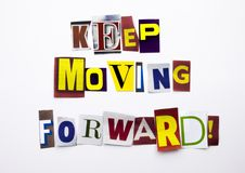 A word writing text showing concept of Keep Moving Forward made of different magazine newspaper letter for Business case on the wh Royalty Free Stock Photos