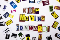 A word writing text showing concept of Keep Moving Forward made of different magazine newspaper letter for Business case on the wh Royalty Free Stock Image