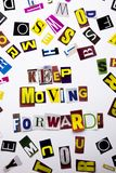 A word writing text showing concept of Keep Moving Forward made of different magazine newspaper letter for Business case on the wh Royalty Free Stock Images