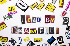A word writing text showing concept of Lead By Example made of different magazine newspaper letter for Business case on the white. Background with space Royalty Free Stock Images