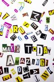 A word writing text showing concept of Make Today Amazing made of different magazine newspaper letter for Business case on the whi. Te background with space royalty free stock photo