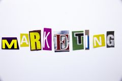 A word writing text showing concept of Marketing made of different magazine newspaper letter for Business case on the white backgr royalty free stock image