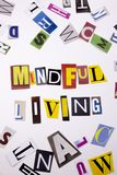 A word writing text showing concept of MINDFUL LIVING made of different magazine newspaper letter for Business case on the white b. Ackground with space Stock Photo