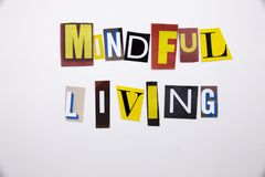 A word writing text showing concept of MINDFUL LIVING made of different magazine newspaper letter for Business case on the white b. Ackground with space Stock Photos