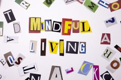 A word writing text showing concept of MINDFUL LIVING made of different magazine newspaper letter for Business case on the white b Stock Photo