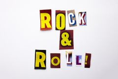 A word writing text showing concept of Rock And Roll made of different magazine newspaper letter for Business case on the white ba Royalty Free Stock Photos