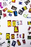 A word writing text showing concept of Rock And Roll made of different magazine newspaper letter for Business case on the white ba Stock Image