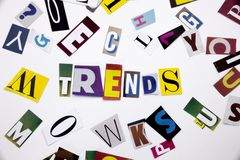 A word writing text showing concept of TRENDS made of different magazine newspaper letter for Business case on the white backgroun Stock Photo