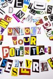 A word writing text showing concept of Unlock Your Potential made of different magazine newspaper letter for Business case on the. White background with space Royalty Free Stock Images