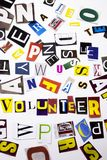A word writing text showing concept of Volunteer made of different magazine newspaper letter for Business case on the white backgr stock photography