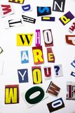 A word writing text showing concept of Who Are You made of different magazine newspaper letter for Business case on the white back. Ground with space royalty free stock images