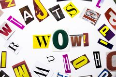 A word writing text showing concept of Wow made of different magazine newspaper letter for Business case on the white background w Stock Image