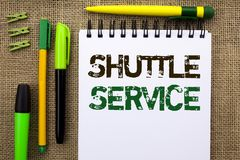 Word writing text Shuttle Service. Business concept for Transportation Offer Vacational Travel Tourism Vehicle written on Notebook. Word writing text Shuttle Stock Photos
