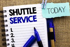 Word writing text Shuttle Service. Business concept for Transportation Offer Vacational Travel Tourism Vehicle written on Notebook. Word writing text Shuttle Stock Photography