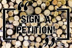 Word writing text Sign A Petition. Business concept for Support a cause by signing paper with an agreement Wooden. Background vintage wood wild message ideas royalty free stock images