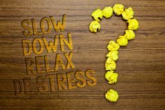 Word writing text Slow Down Relax De Stress. Business concept for Have a break reduce stress levels rest calm Wooden floor with so. Me letters yellow paper lumps stock images