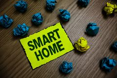 Word writing text Smart Home. Business concept for automation system control lighting climate entertainment systems Yellow piece p. Aper reminder lots crumpled royalty free stock images