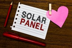 Word writing text Solar Panel. Business concept for designed to absorb suns rays source of energy generating Notebook piece paper. Markers clothespin holding royalty free stock image