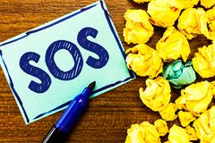 Word writing text Sos. Business concept for Urgent appeal for help International code signal of extreme distress.  stock photo