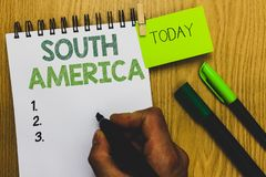 Word writing text South America. Business concept for Continent in Western Hemisphere Latinos known for Carnivals Man holding mark. Er notebook clothespin royalty free stock photos