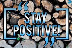 Word writing text Stay Positive. Business concept for Be Optimistic Motivated Good Attitude Inspired Hopeful Wooden background. Vintage wood wild message ideas royalty free stock image